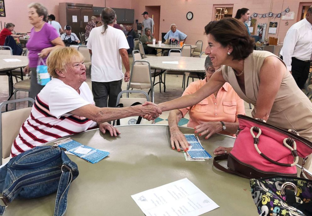 PHOTO: Rhode Island Gov. Gina Raimondo, right, shakes hands with a woman at the Pilgrim Senior Center in Warwick, R.I., Aug. 2, 2018.