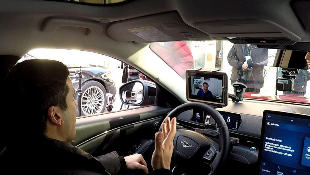 PHOTO: ABC News transportation correspondent Gio Benitez talks to Ford General Manager of Battery Electric Vehicles Darren Palmer during a test drive, on Feb. 8, 2021.