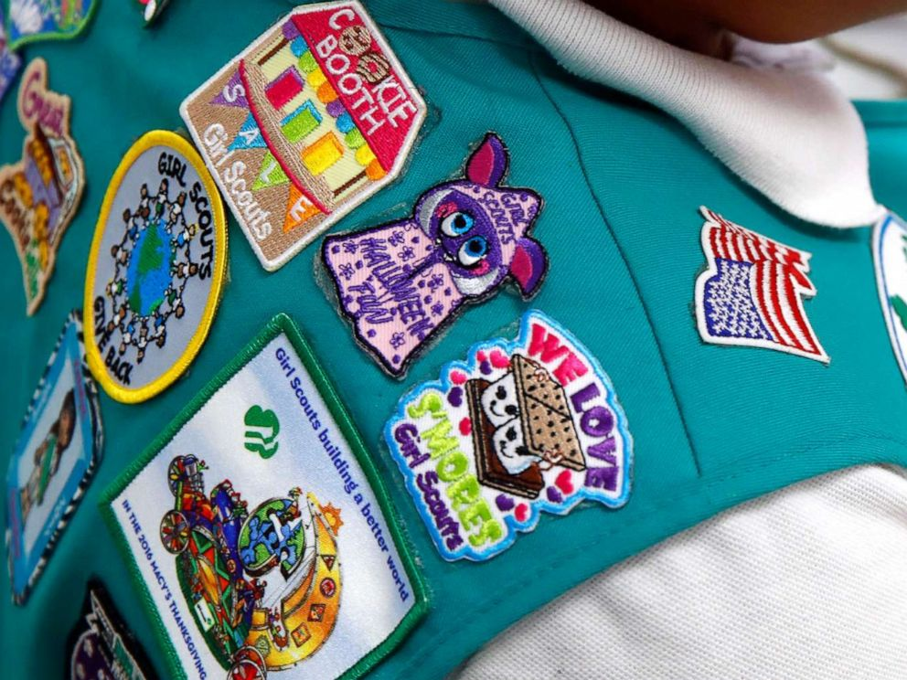 PHOTO: In this July 21, 2017, photo, badges are seen on the vest of a member of the Girl Scouts as she participates in an activity introducing the world of robotics in Owings Mills, Md.