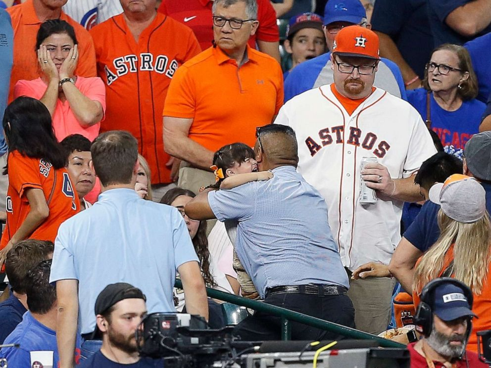 PHOTO: A young child is rushed from the stands after being injured by a hard foul ball off the bat of Albert Almora Jr. of the Chicago Cubs at Minute Maid Park on May 29, 2019, in Houston.