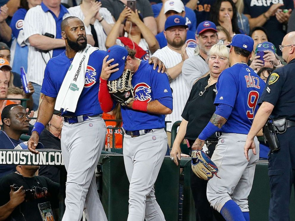 PHOTO: Albert Almora Jr. of the Chicago Cubs is comforted by Jason Heyward after checking on the young child that was injured by a hard foul ball off his bat at Minute Maid Park on May 29, 2019, in Houston.