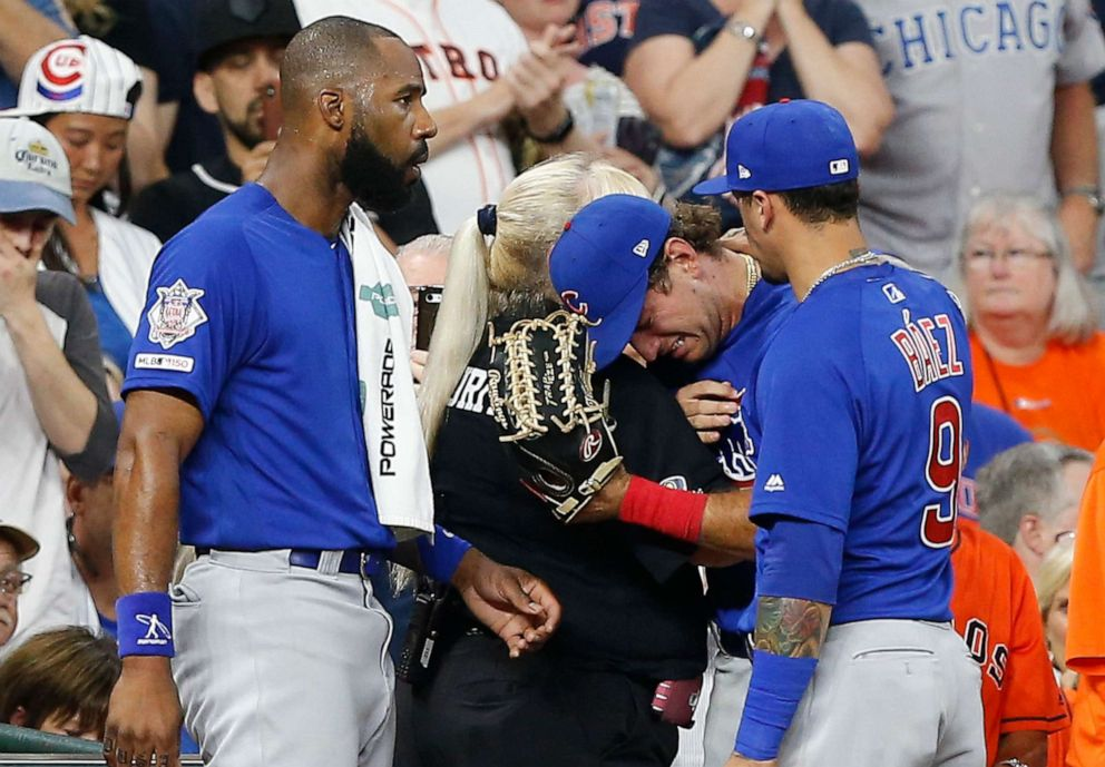 PHOTO: Albert Almora Jr. of the Chicago Cubs, center, is comforted by a security guard after checking on a young child that was struck by a hard foul ball off his bat at Minute Maid Park on May 29, 2019, in Houston.