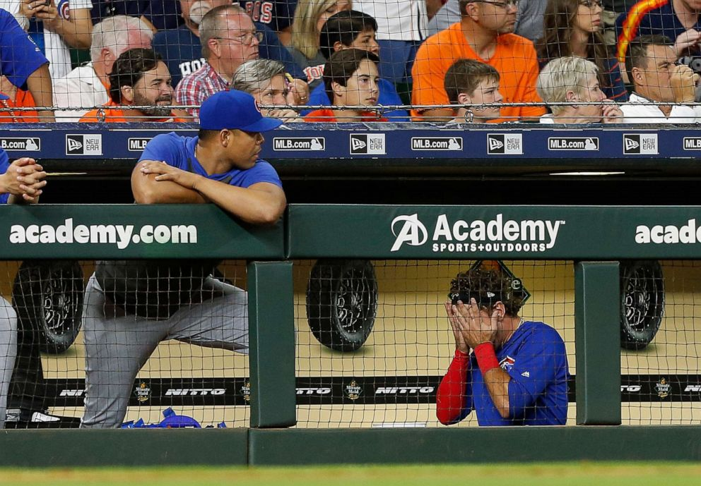 PHOTO: Albert Almora Jr. of the Chicago Cubs leaves the game after checking on the young child that was hit by a foul ball off his bat in the fourth inning against the Houston Astros at Minute Maid Park on May 29, 2019 in Houston.