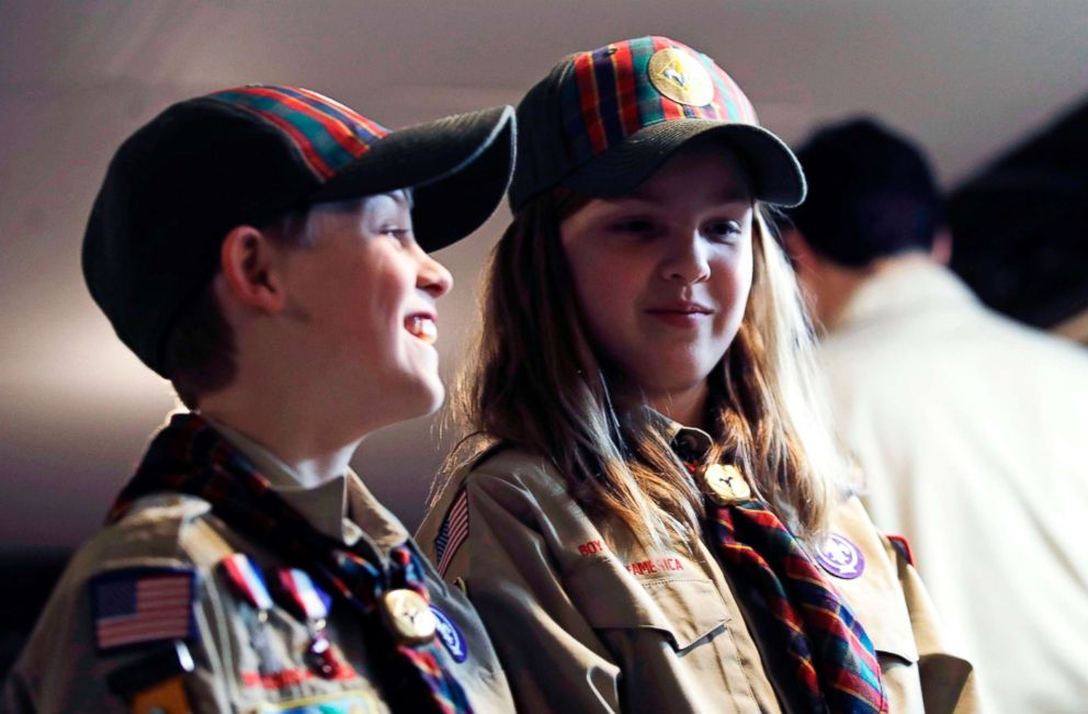 PHOTO: Ian Weir, left, stands with his twin sister Tatum after a cub scout meeting in Madbury, N.H, March 1, 2018. The twins already are planning to become the first set of girl-boy siblings to become Eagle Scouts.