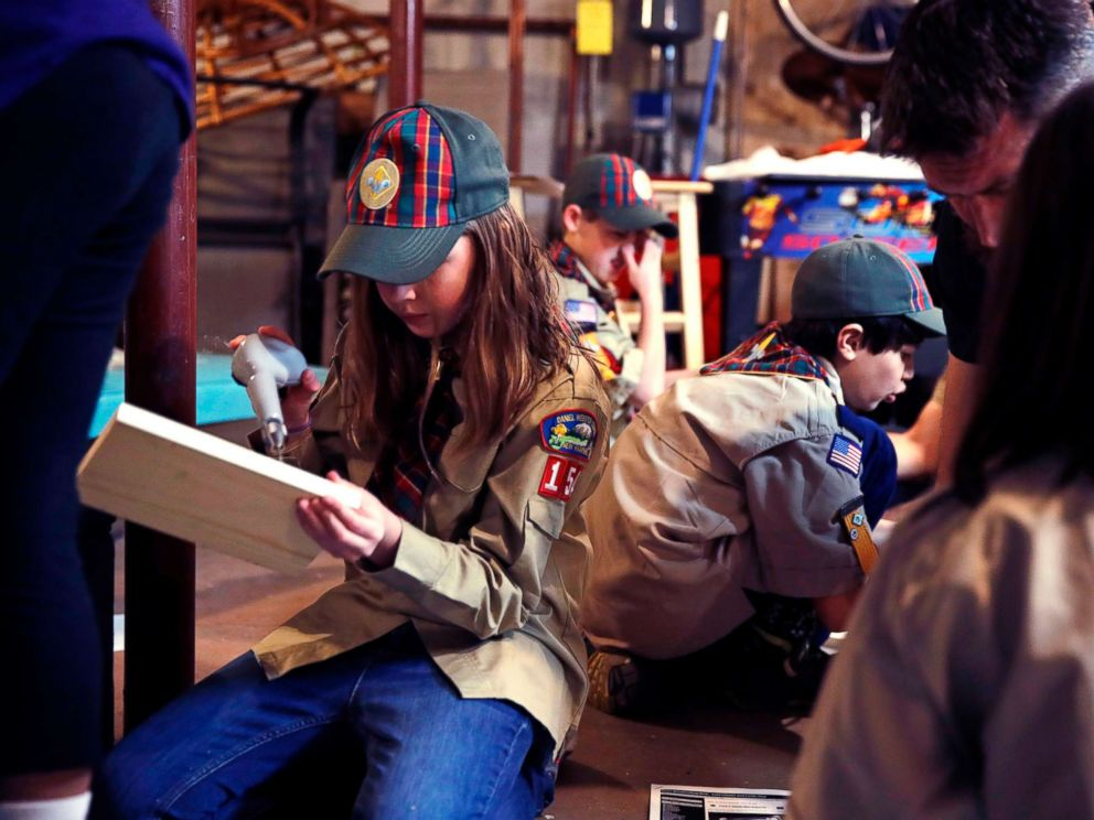 PHOTO: Tatum Weir, left, sets to drill a pilot hole while building a tool box during a cub scout meeting in Madbury, N.H, March 1, 2018.