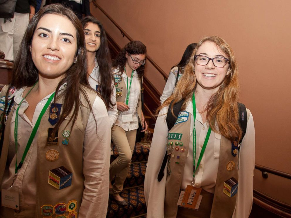 PHOTO: California Girl Scout Gold Award recipients Daniela Castro (L) and Sarah Gillespie (center) of Girl Scouts of Greater Los Angeles walk the halls of the State Capitol with their fellow awardees, on June 23, 2016, in Sacramento, Calif.