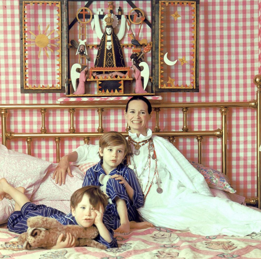 PHOTO: Socialite and heiress Gloria Vanderbilt poses for a portrait session with her sons Anderson Cooper (left) and Carter Vanderbilt Cooper on a bed in their home, March 30, 1972, in Southampton, Long Island, New York.