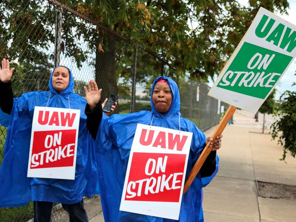 PHOTO: United Auto Workers, Aramark workers, carry strike signs outside the General Motors Detroit-Hamtramck assembly plant in Detroit, Sept. 15, 2019.