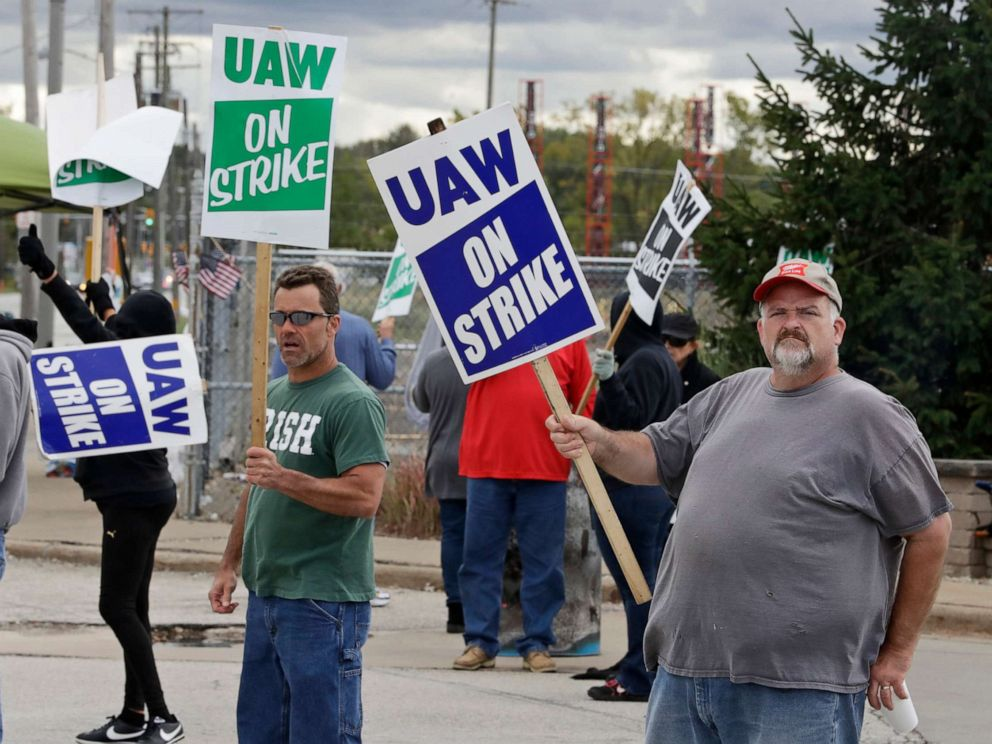 PHOTO: John Kirk, right, a 20-year-employee, pickets with co-workers outside the General Motors Fabrication Division, Oct. 4, 2019, in Parma, Ohio.