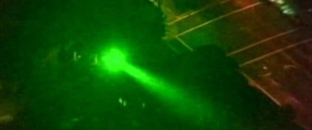 PHOTO: File footage from federal officials shows the effect of a green laser pointed towards an aircraft.