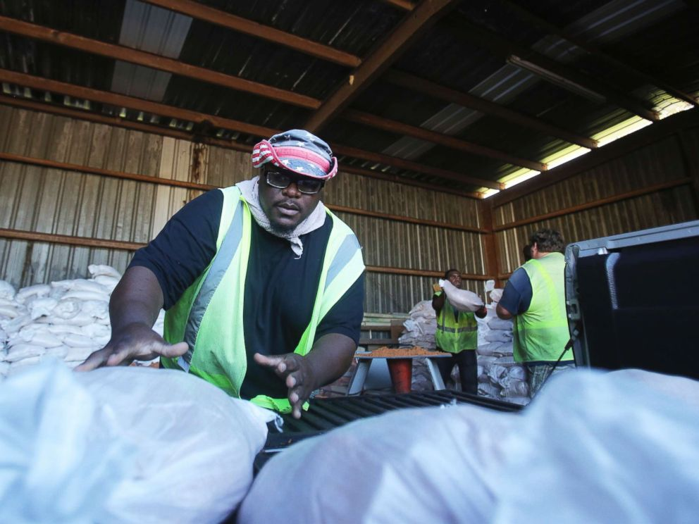 PHOTO: Marquis Chaney, with the City of Saraland, loads a truck up with sand bags to help residents prepare for Tropical Storm Gordon, Sept. 4, 2018, in Saralad, Ala.