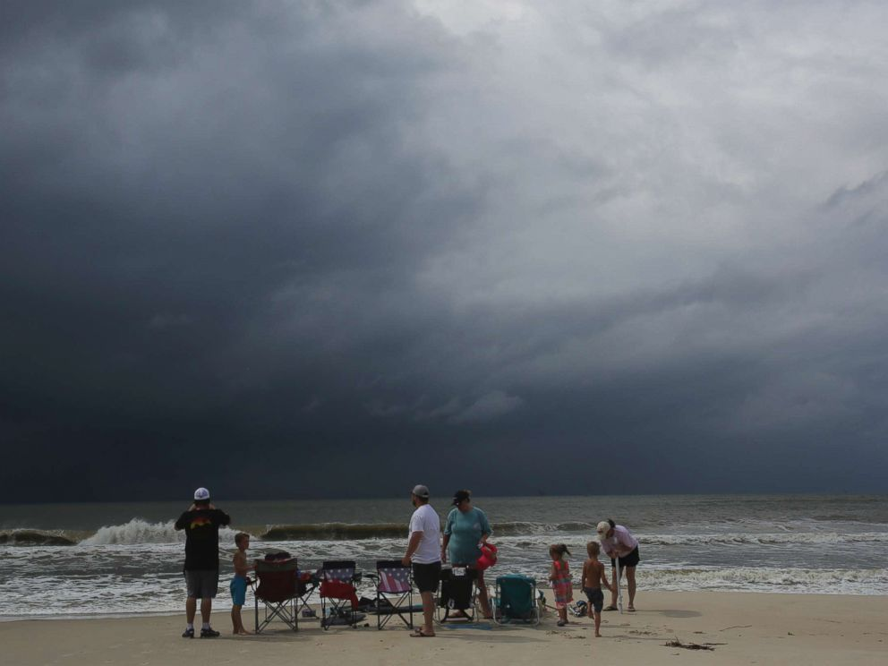PHOTO: A family watches the first rains clouds from Tropical Storm Gordon roll in, Sept. 4, 2018, in Dauphin Island, Ala.