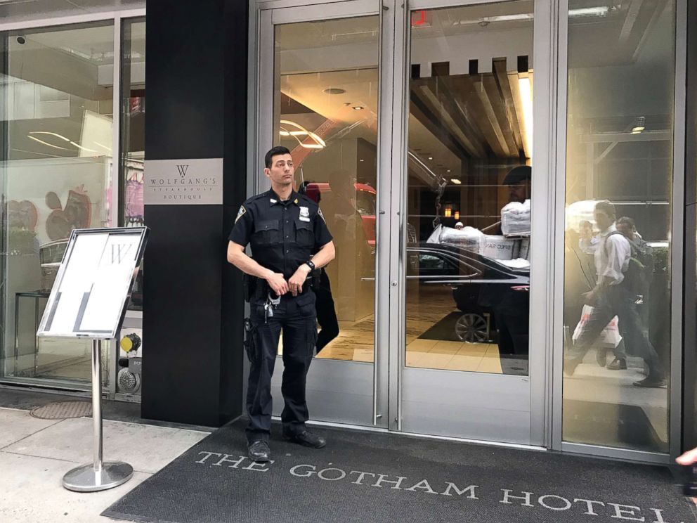 PHOTO: A police officer stands outside the Gotham Hotel in New York after reports that a woman jumped from the building with a child on May 18, 2018.