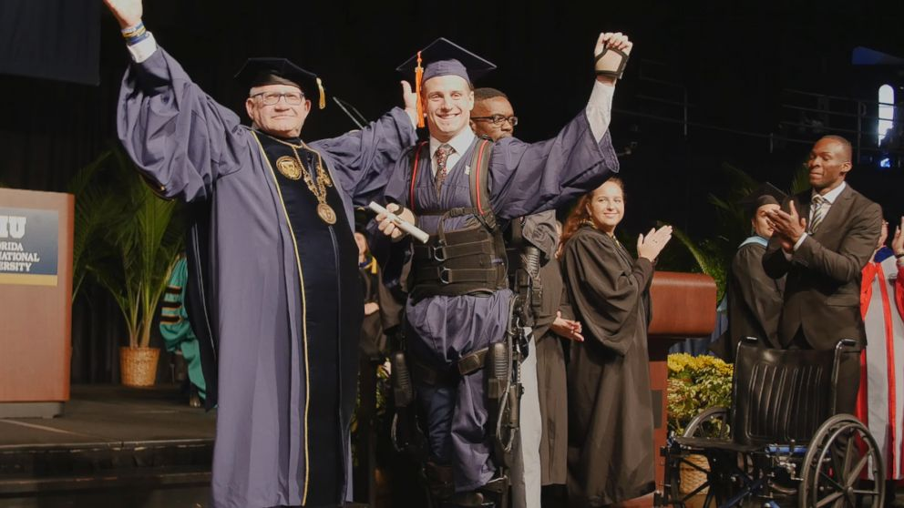 Aldo Amenta used an exoskeleton to walk across the stage to get his diploma at Florida International University.