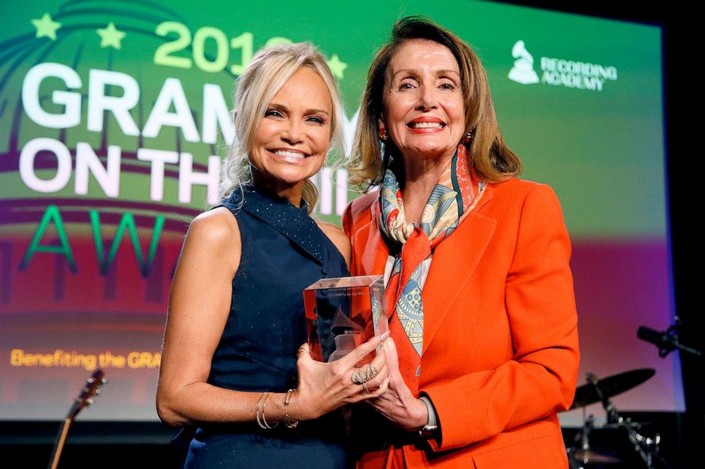 PHOTO: Kristin Chenoweth and Nancy Pelosi pose on stage at GRAMMYs on the Hill 2019 on April 9, 2019 in Washington, D.C.