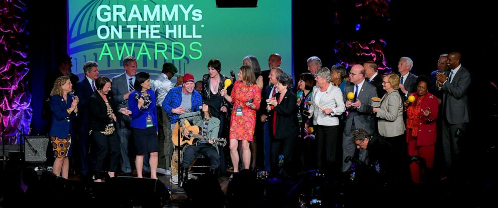 PHOTO: Linda Perry performs on stage with representatives and honorees at GRAMMYs on the Hill 2019, April 9, 2019, in Washington, D.C.