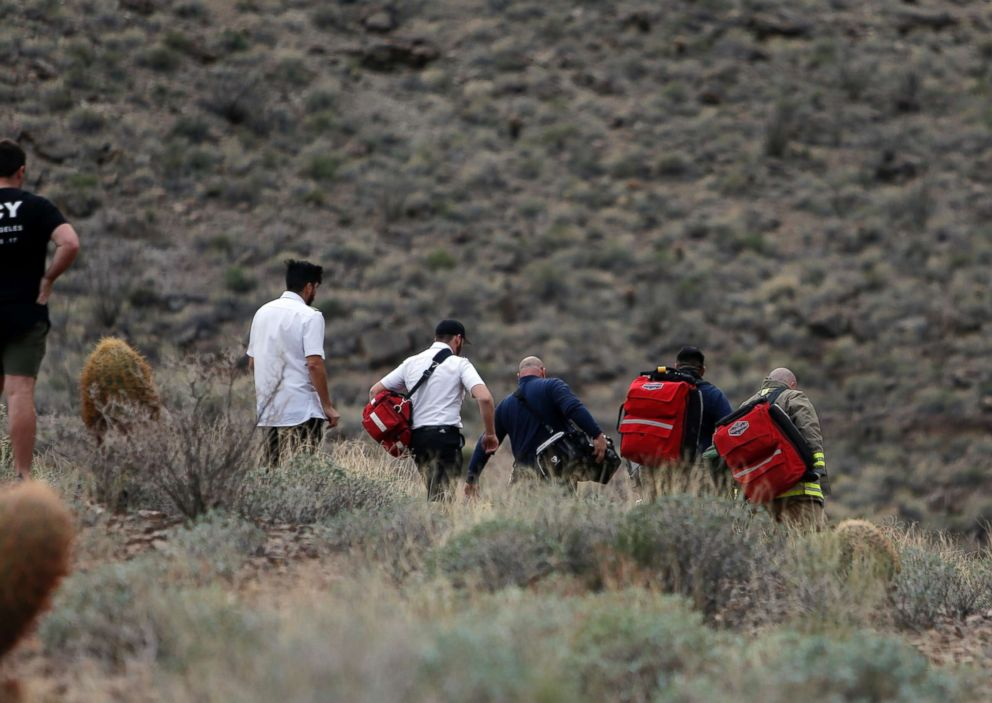 PHOTO: Emergency personnel arrive at the scene of a deadly tour helicopter crash along the jagged rocks of the Grand Canyon Feb. 10, 2018, in Arizona.