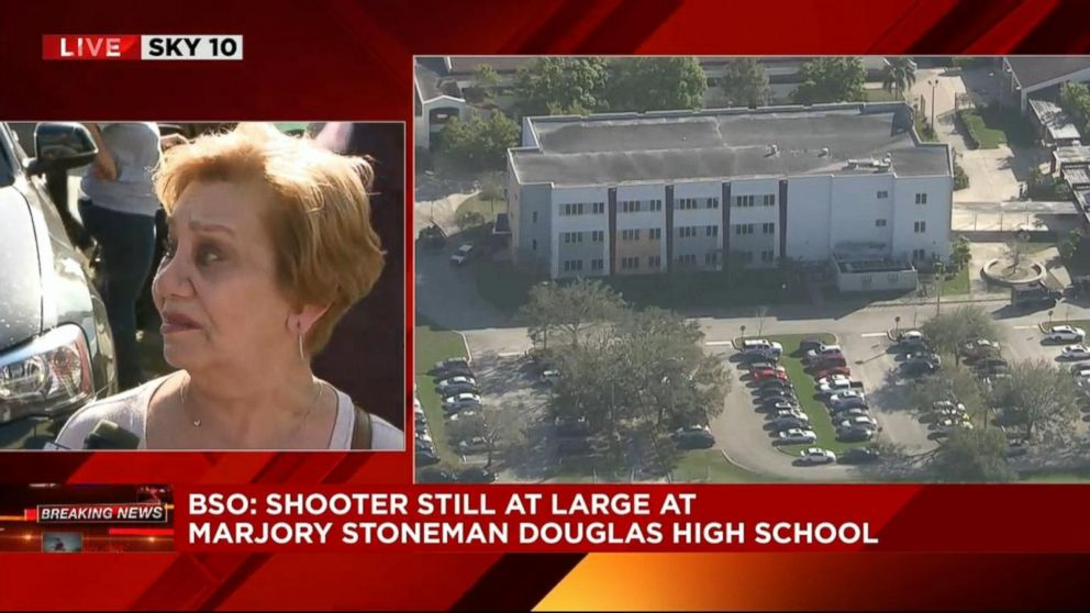 PHOTO: A woman said she was visiting from New York and was waiting to hear from her granddaughter at Stoneman Douglas High School in Parkland, Fla., Feb. 14, 2018.
