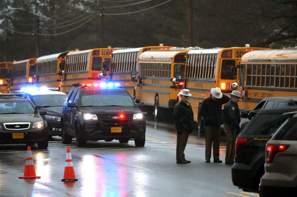 PHOTO: School buses are lined up in front of Great Mills High School after a shooting on March 20, 2018 in Great Mills, Md.
