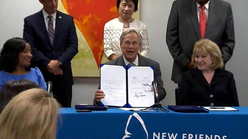 PHOTO: Texas Governor Greg Abbott signs a fertility fraud bill into law during a press conference, June 5, 2019.