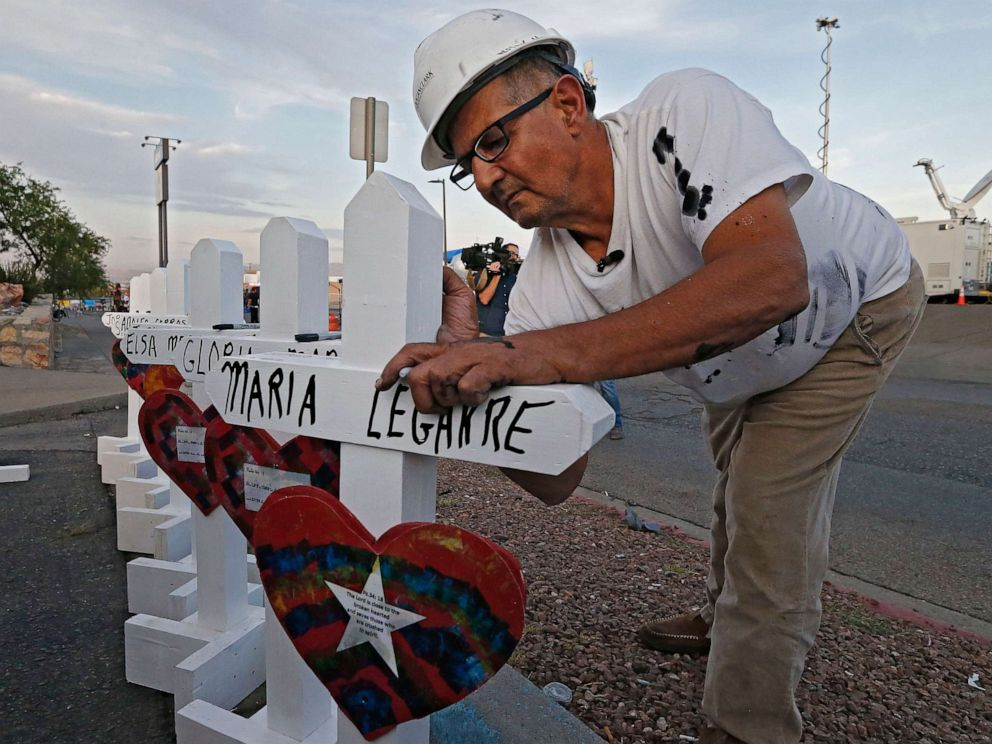 PHOTO: Greg Zanis with Crosses for Losses signs a cross at a makeshift memorial for the victims of a mass shooting that happened at a Walmart in El Paso, Texas, Aug. 5, 2019.