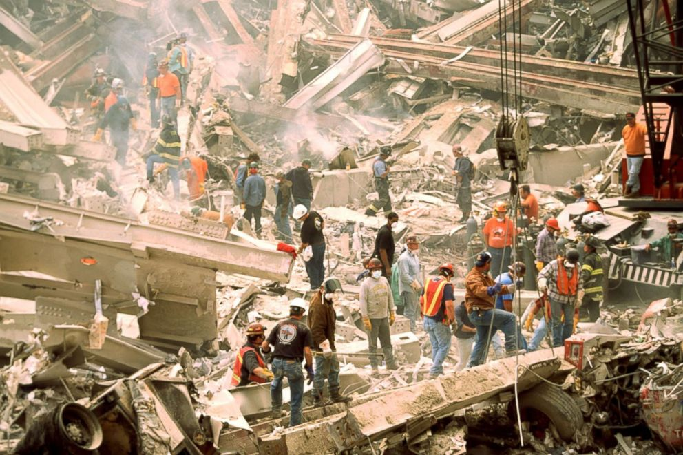 PHOTO: Firefighters search for survivors at the wreckage of the World Trade Center Towers on Sept. 12, 2001, after a terrorist attack in New York.