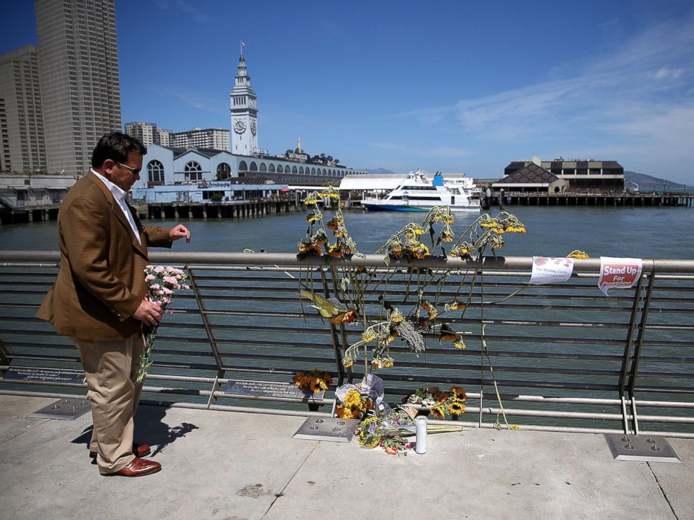 PHOTO: A well-wisher drops off flowers at the site where 32-year-old Kate Steinle was killed on July 6, 2015 in San Francisco.