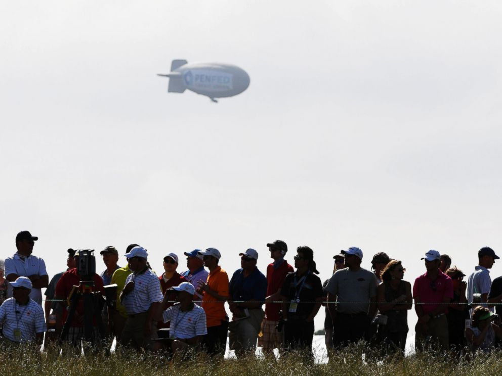 PHOTO: A blimp floats over the crowd during the first round of the 2017 U.S. Open at Erin Hills on June 15, 2017 in Hartford, Wis.