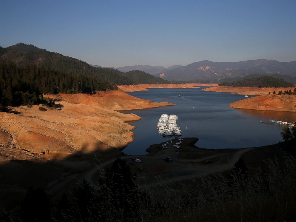 PHOTO: Houseboats are dwarfed by the steep banks of Shasta Lake at Bridge Bay Resort on Aug. 31, 2014 in Redding, Calif. when the lake reached about 30 percent of its total capacity, the lowest it had been since 1977.