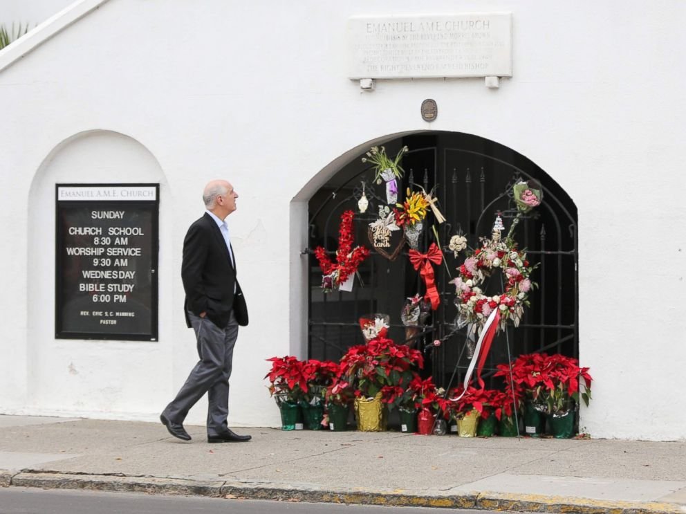 PHOTO: A man stops to observe the makeshift memorial in front of Mother Emanuel AME Church in downtown Charleston, South Carolina on Jan. 4, 2017.