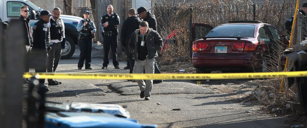 PHOTO: Police look over a bullet-riddled car after a gunman killed a two-year-old child, a man in his twenties and wounded a pregnant woman in the Lawndale neighborhood on Feb. 14, 2017 in Chicago.
