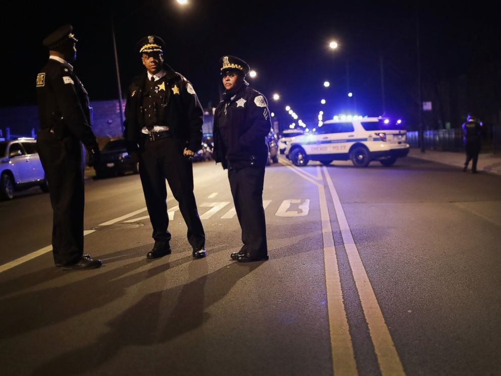 PHOTO: Police monitor a vigil being held in the Park Manor neighborhood to honor 11-year-old Takiya Holmes who died after being shot in the head by a stray bullet, Feb. 14, 2017 in Chicago.