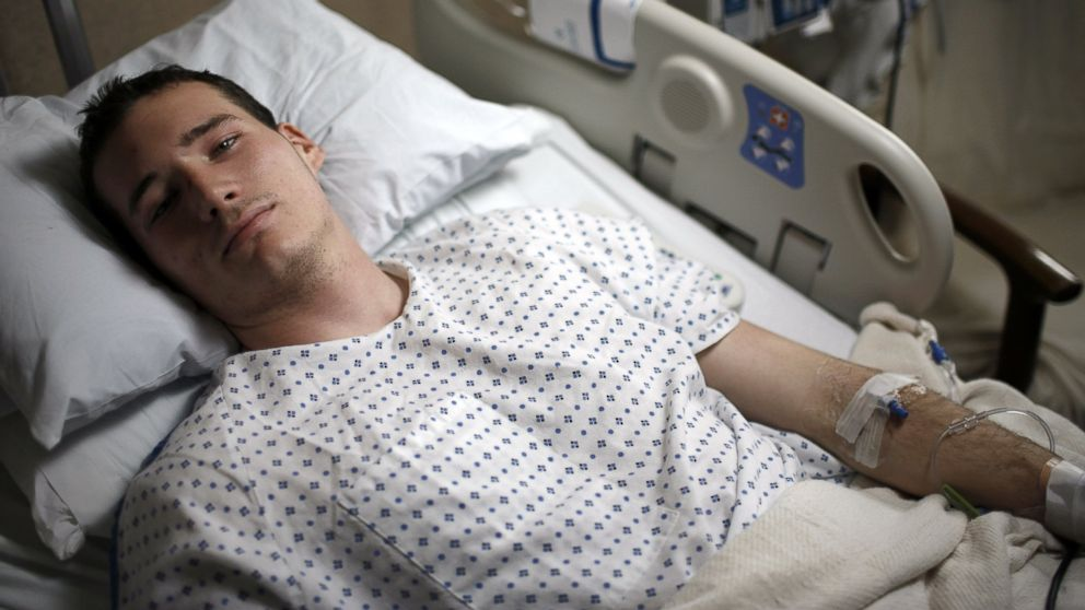 Virginia Tech student Colin Goddard lies in his hospital bed on April 19, 2007 in Blacksburg, Va. Colin was shot three times and was featured in newspapers around the world after being photographed being carried out of Norris Hall, April 16, 2007 in Blacksburg, Va.