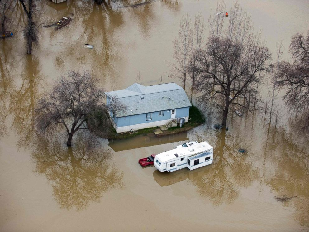 PHOTO: A home is seen marooned as the surrounding property is submerged in flood water in Oroville, California, Feb. 13, 2017.
