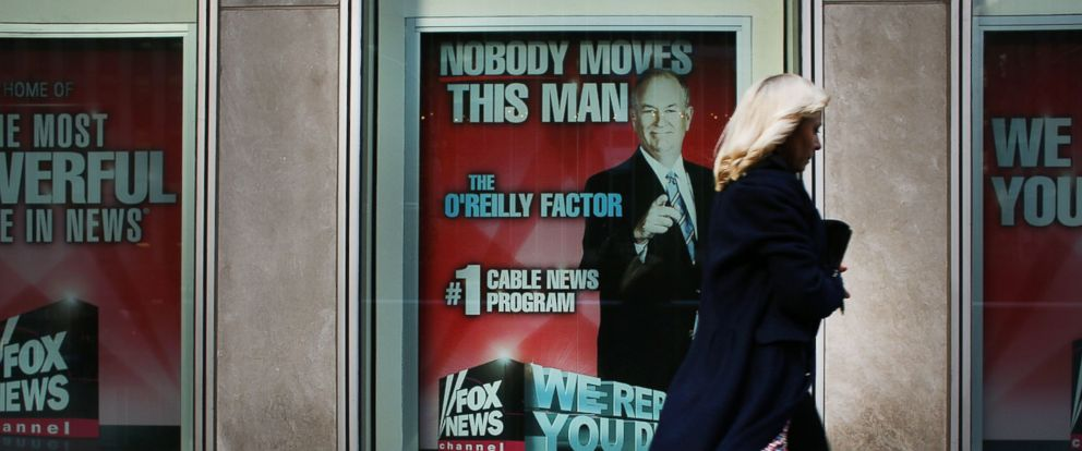 PHOTO: An advertisement for Bill OReillys top-rated Fox News show is displayed in the window of the News Corporation headquarters on April 5, 2017 in New York.