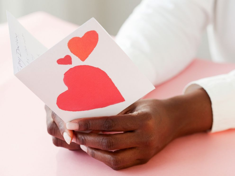 PHOTO: A woman holds a Valentine card in an undated stock photo.