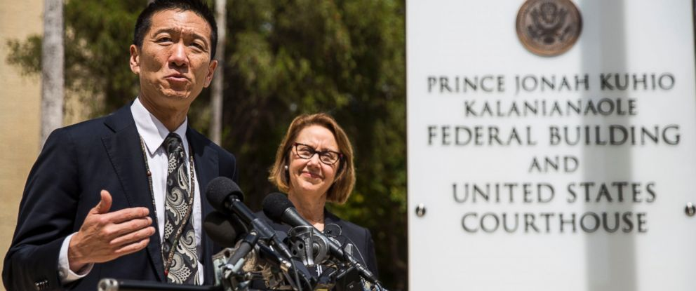 PHOTO: Hawaii State Attorney General Douglas Chin speaks as Oregon Attorney General Ellen Rosenblum looks on at a press conference in front of the Prince Jonah Kuhio Federal Building and US District Courthouse on March 15, 2017 in Honolulu.