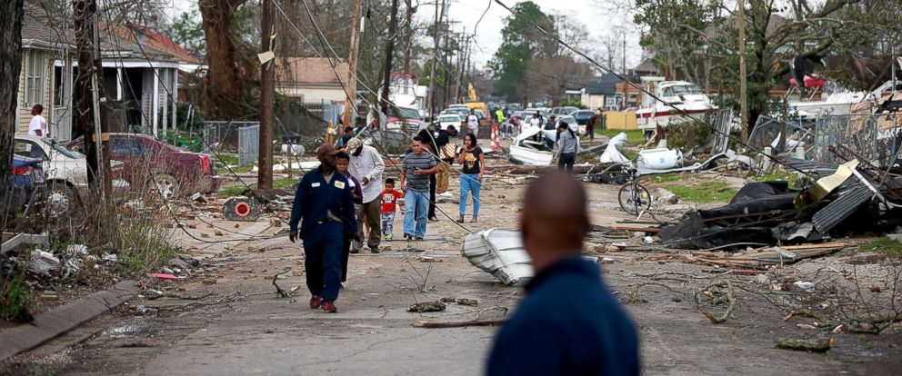 PHOTO: Residents walk in the street after a tornado touched down in the eastern part of New Orleans on Feb. 7, 2017.