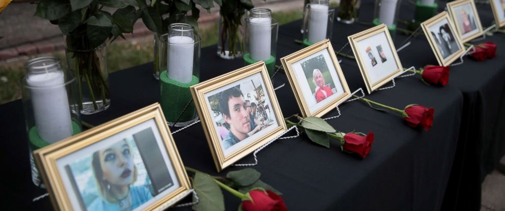 PHOTO: Pictures of victims of the Santa Fe High School shooting are displayed during a prayer vigil at Walter Hall Park, May 20, 2018, in League City, Texas.