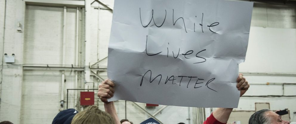 """PHOTO: A Trump supporter holds up a """"White Lives Matter"""" sign during a rally for Republican Presidential Candidate Donald Trump on April 6, 2016 in Bethpage, New York."""