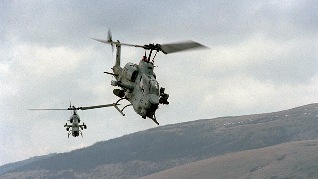PHOTO: Two U.S. Marine AH-1W Super Cobra helicopters from the 26th Marine Expeditionary Unit training.