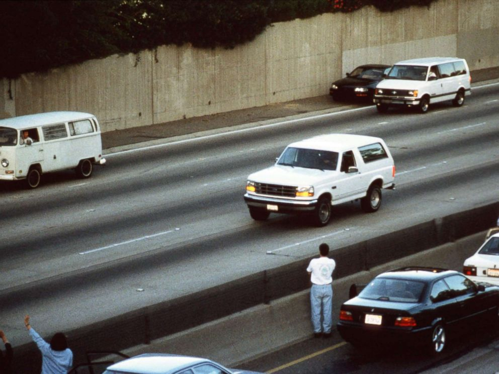 PHOTO: Motorists wave as police cars pursue the Ford Bronco carrying fugitive murder suspect O.J. Simpson on a 90-minute slow-speed car chase June 17, 1994 on the 405 freeway in Los Angeles, Calif.
