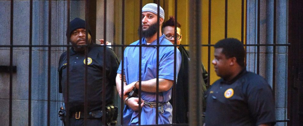"""PHOTO: Officials escort """"Serial"""" podcast subject Adnan Syed from the courthouse following the completion of the first day of hearings for a retrial in Baltimore on Feb. 3, 2016."""
