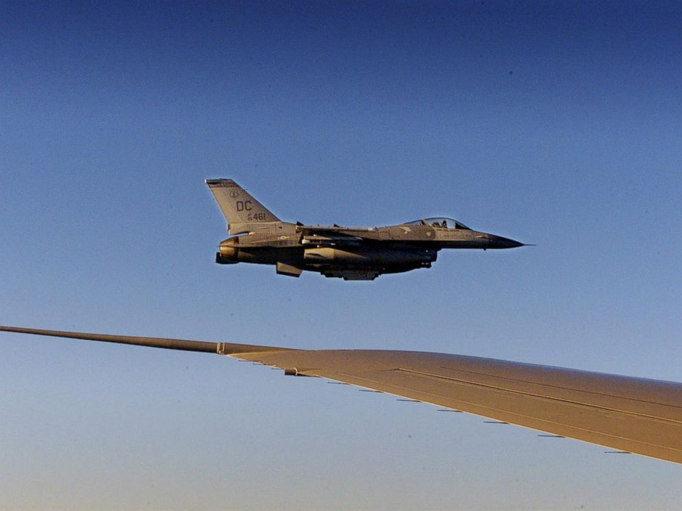 PHOTO: An F-16 fighter flies just off the wing of Air Force One on a flight back to Washington, Sept. 11, 2001.
