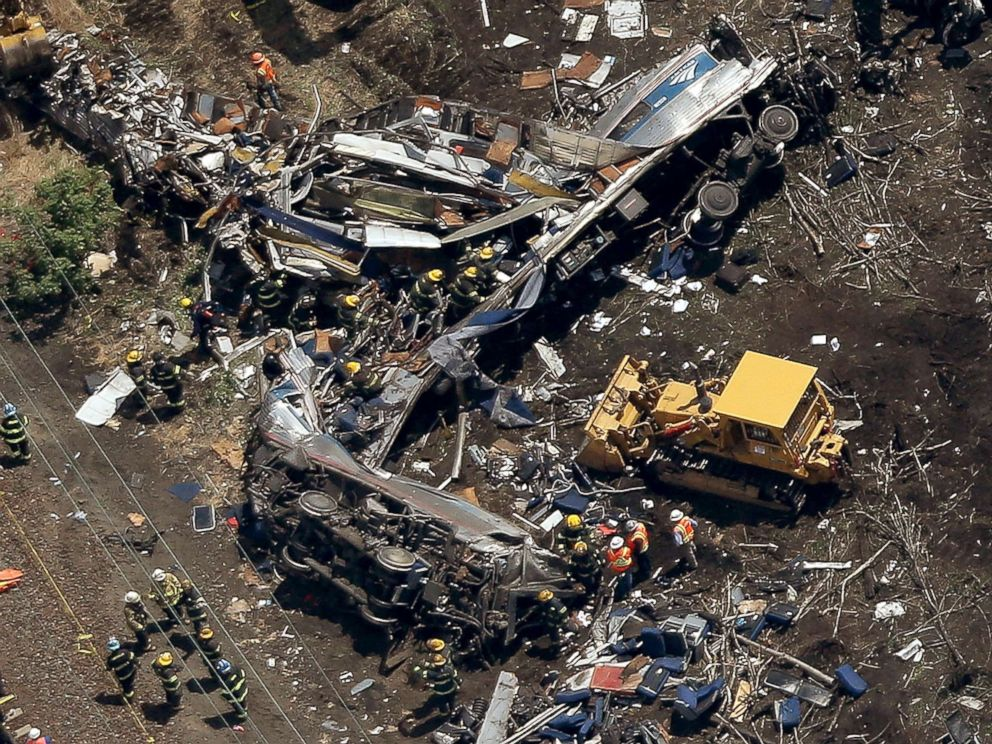 PHOTO: Investigators work near the wreckage of a derailed Amtrak passenger train in this May 13, 2015 file photo in north Philadelphia.
