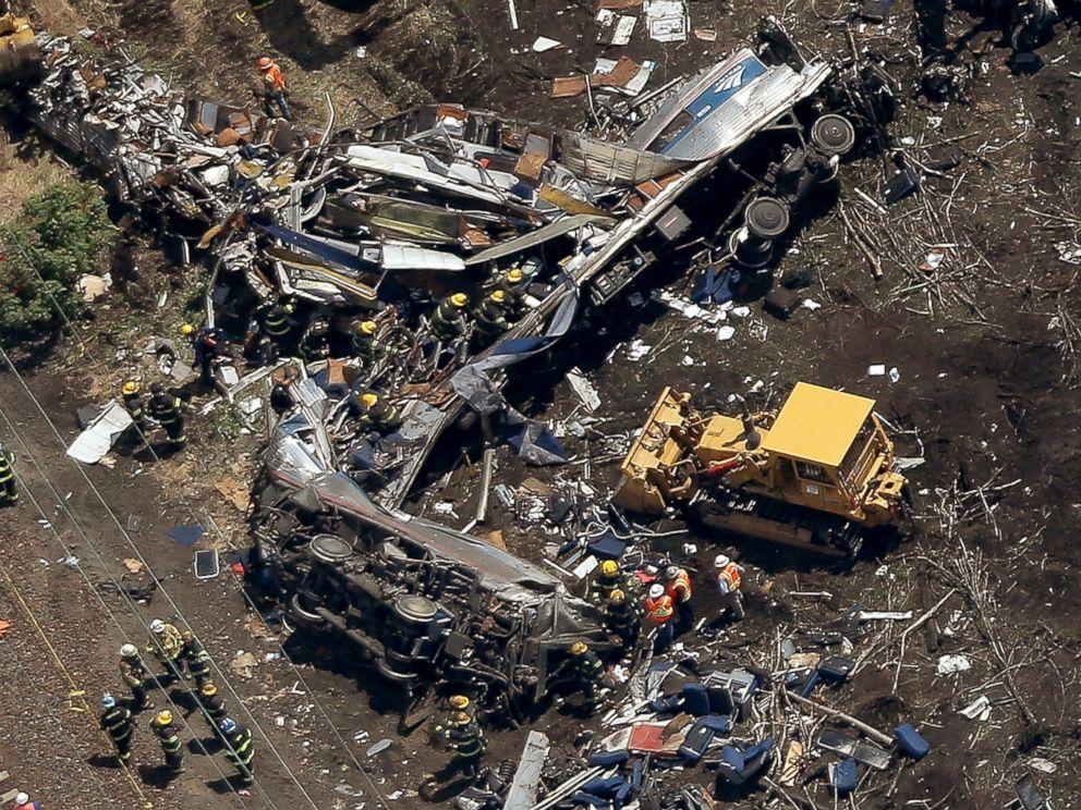 PHOTO: Investigators work near the wreckage of a derailed Amtrak passenger train, May 13, 2015 in north Philadelphia.