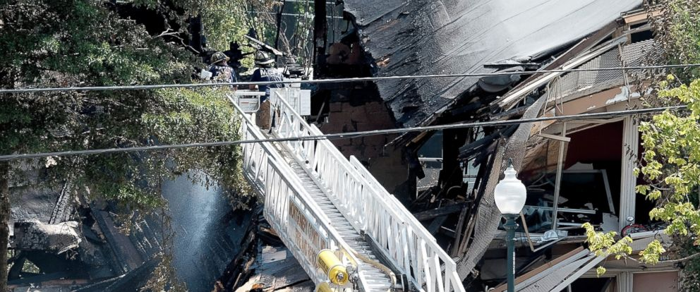 Explosion fire at maryland apartment complex leave 2 dead 34 photo firefighters on a ladder truck spray water on the still smoldering remains of mightylinksfo