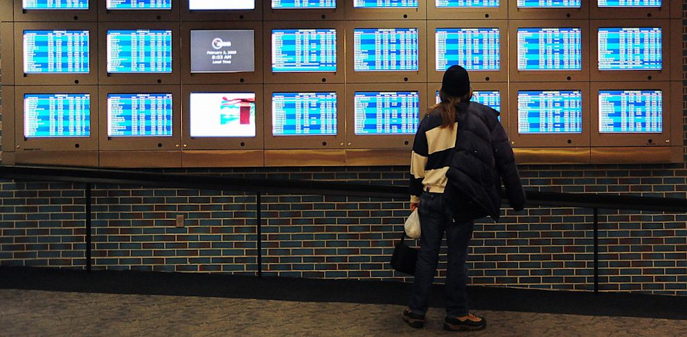 PHOTO: A traveler checks the arrival/departure board