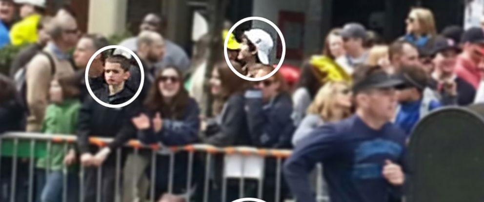 PHOTO: A cell phone image appears to show Boston Marathon bombing suspect #2, Dzhokhar A. Tsarnaev, near a young boy who is standing on the railing and thought to be eight-year-old victim Martin Richard on Boylston Street April 15, 2013 in Boston.