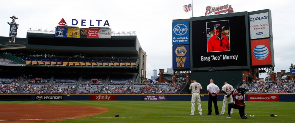"PHOTO: An American flag is lowered to half-staff in memory of Greg ""Ace"" Murrey who fell to his death at the game between the Atlanta Braves and the New York Yankees, Aug. 30, 2015 in Atlanta."